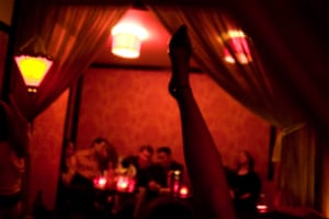 A leg raised in the air at the swingers club