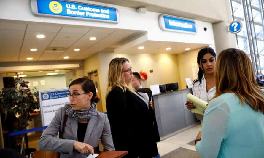 Lawyers work on paperwork to help family members of passengers effected by the travel ban outside the US Customs and Border Protection office at Los Angeles international airport on Saturday.