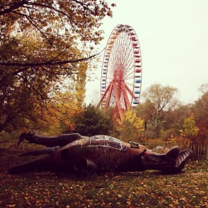 Fallen GiantsAn abandoned communist era theme park in Berlin. We had to sneak in under the fence. It was particularly creepy when the breeze made the ferris wheel slowly creek into motion Photograph: Laura Nunneley/GuardianWitness