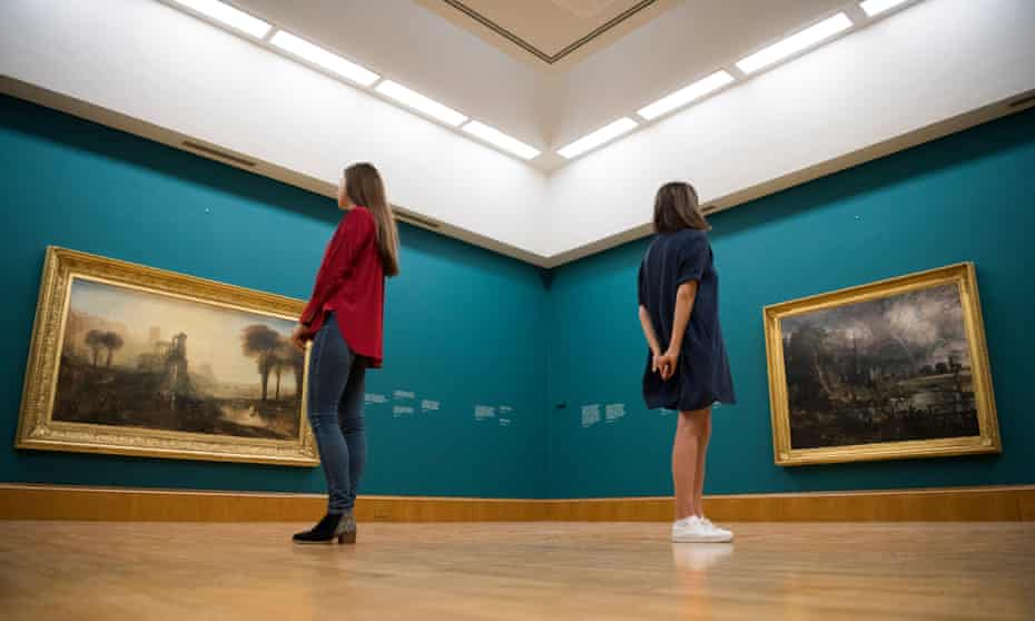 Tate Britain staff examine JMW Turner's Caligula's Palace and Bridge (left) John Constable's Salisbury Cathedral in the Meadow, both created in 1831.