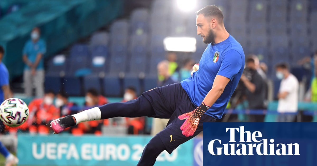 Italy's Donnarumma ignores whistles and fake money to set records