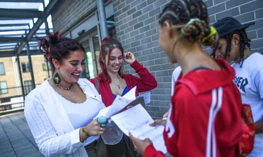 Students in England receive their A-level results.