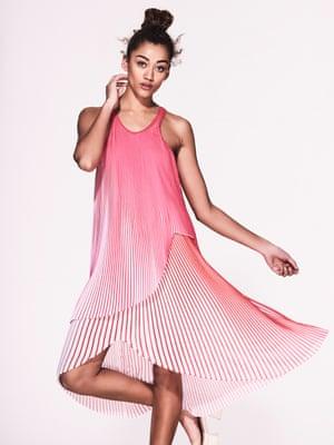 Model wears pink pleated dress