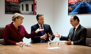 David Cameron in conversation with Angela Merkel and Francois Hollande at the EU summit in Brussels.