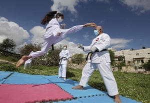 Beesan al-Jubeh, Palestinian under-10s national karate champion, trains with her father Sami outside their house in the city of Hebron in the occupied West Bank.