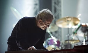 Dieter Moebius of Cluster performs on stage.