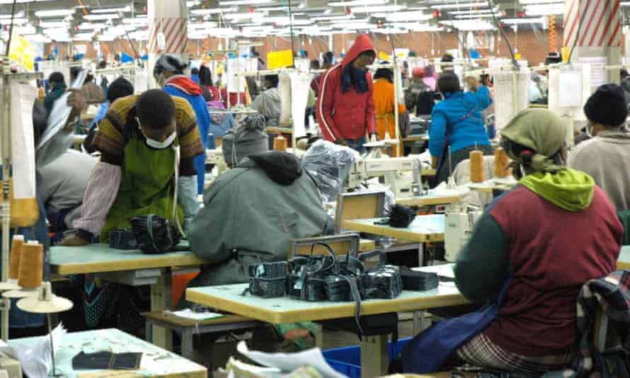 Textile workers at a factory making jeans