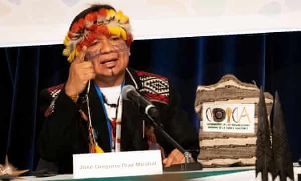 José Gregorio Diaz Mirabal, indigenous leader, in feathered headdress