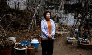 Kim Ryon-hui outside the group home in Seoul where she lives with others who want to return to North Korea.