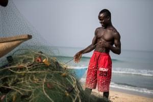 A fisherman in Robertsport checks his nets