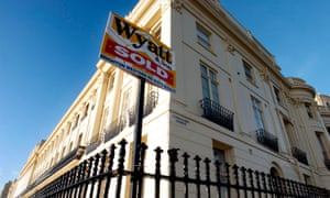 House sold sign on a period home in Brunswick Terrace, Hove.