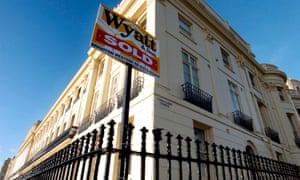 House sold sign on a period home in Brunswick Terrace, Hove