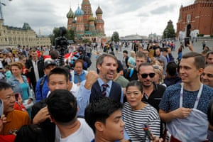 Moscow, Russia Tourists gather round Neil Rowe, a Gareth Southgate look-a-like, in Red Square on the day before England's World Cup semi-final against Croatia