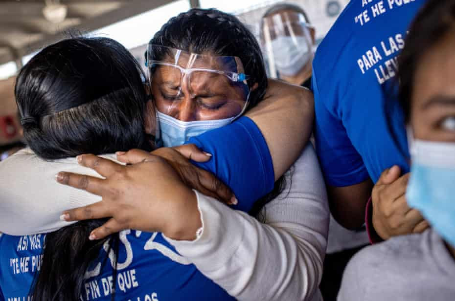 A Honduran asylum seeker has an emotional reunion with a church volunteer upon arrival to the US in Brownsville, Texas, on 26 February 2021.