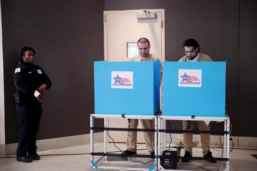 Inmates at the Cook county jail cast their votes in the Illinois primary election after a polling place in the facility was opened for early voting on 7 March 2020 in Chicago, Illinois.
