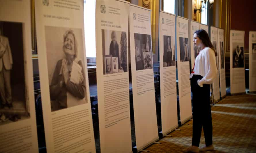A visitor studies stories of Holocaust victims during the annual Holocaust memorial commemoration event at the Foreign & Commonwealth Office on 23 January.