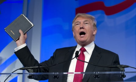 Donald Trump holds up his bible during the Values Voter Summit.