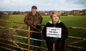Jimmy and Gillian Morris campaigning against proposals to build hundreds of houses and a motorway link road within the green belt on their farm land at Kitt Green, Wigan