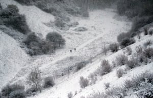 People make their way through the snow in Wye National Nature Reserve near Ashford in Kent