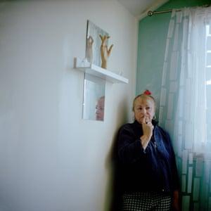 A woman standing near a window