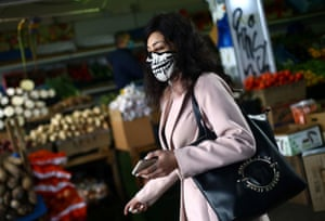 A woman wearing a face mask in Peckham, London