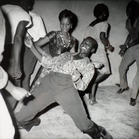 Young man showing off his dance moves to his fellow revellers