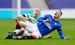 Ryan Kent is tackled by Celtic's Scott Brown.