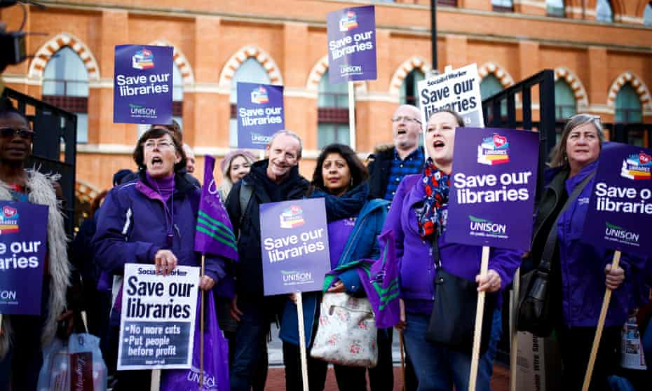 Protesters gather outside the British Library in London to march against government cuts to the arts and public libraries