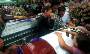 The AUC rightwing paramilitaries left victims all over Colombia. Here family members mourn at a funeral in Buga, about 160 miles south-west of Bogotá in 2001.