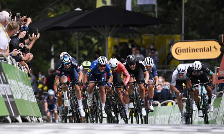 Mark Cavendish emerges from the pack to sprint clear on stage four.