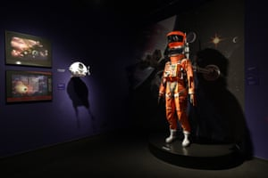 Prints of space and spacecrafts by concept artist Roy Carnon (left) and a space suit worn in the Clavius Base scene in 2001