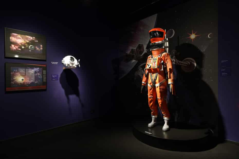 Prints of space and spacecrafts by Roy Carnon, and a space suit worn in 2001.