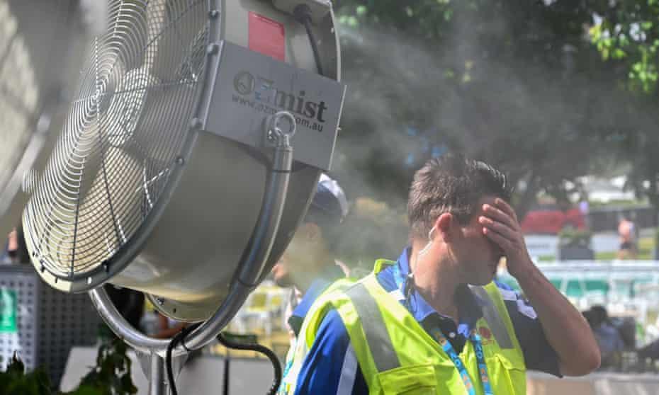 A man in front of a mist fan at the Australian Open tennis tournament