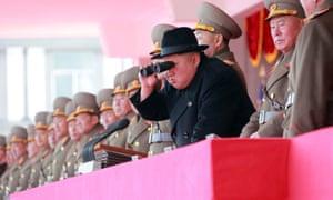 Kim Jong-un watches a military display in Pyongyang.
