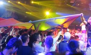 Crowd displays LGBT flag at Mr Gay China final.