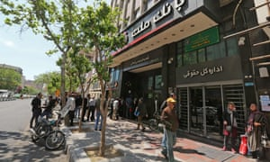 Iranians queue outside a bank in the Islamic Republic's capital, Tehran, last week