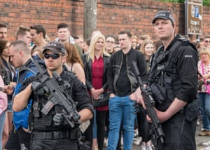 Armed Police patrol at the One Love Manchester Benefit Concert