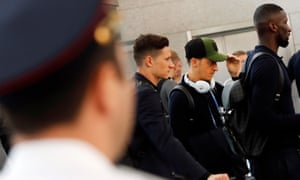 Julian Draxler, left, Mesut Özil and Antonio Rudiger wait to pass an airport security check as Germany's World Cup squad depart from Russia on Thursday