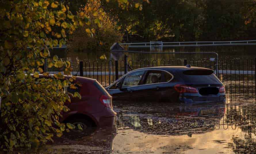 Cars in flood water in Worcester, England