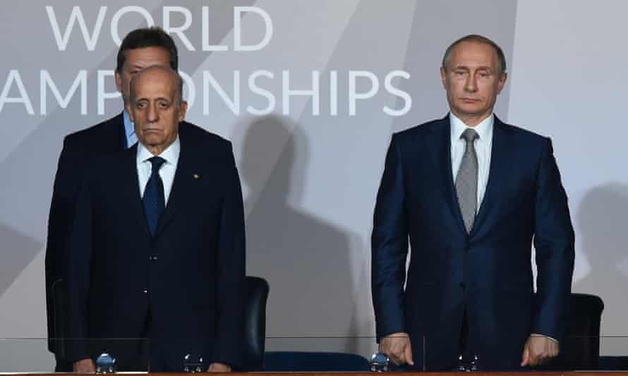 Vladimir Putin, right, at the Fina world championships with Fina president Julio Maglione.