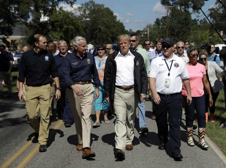 Donald Trump visits an area impacted by the storm.