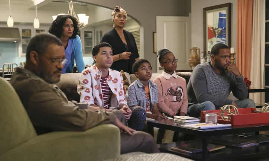 Laurence Fishburne, from left, Tracee Ellis Ross, Marcus Scribner, Jennifer Lewis, standing center, Miles Brown, Marsai Martin and Anthony Anderson appear in an episode of Black-ish about a highly publicized court case involving alleged police brutality and an African-American teenager.