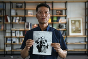 Hwang In-cheol, whose father was kidnapped to North Korea in 1969, holding an old photo of his father. Hwang was only two when his father Won left for a business trip in 1969, never to return.
