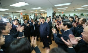 Chinese President Xi Jinping, centre, talks with editors in the general newsroom of the People's Daily in Beijing during a high-profile tour of the country's top three state-run media outlets.