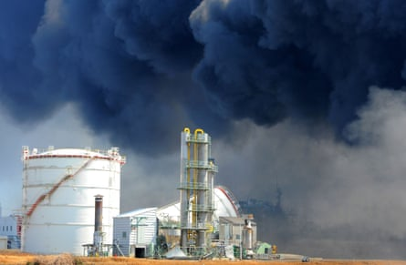 Smoke billows from fires raging at the port in Tagajo, Miyagi prefecture, in March 2011 after a massive earthquake and tsunami.