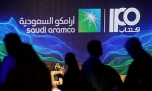 Sign of Saudi Aramco's IPO is seen during a news conference by the state oil company