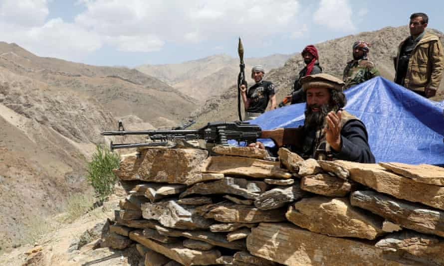 Armed men who are against the Taliban stand at their check post, at the Ghorband District, Parwan Province, Afghanistan