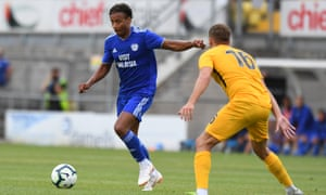 Cardiff City's Bobby Reid takes on Torquay in a friendly