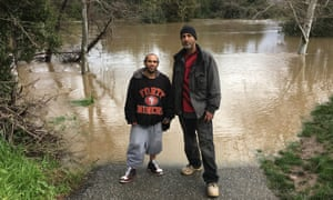 Shortie Mendoza and Phillip Quiroz at a flooded golf course in San Jose, California.