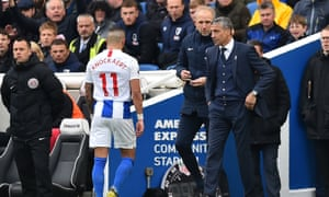Anthony Knockaert walks past Chris Hughton after being shown red in the 5-0 loss to Bournemouth on Saturday.